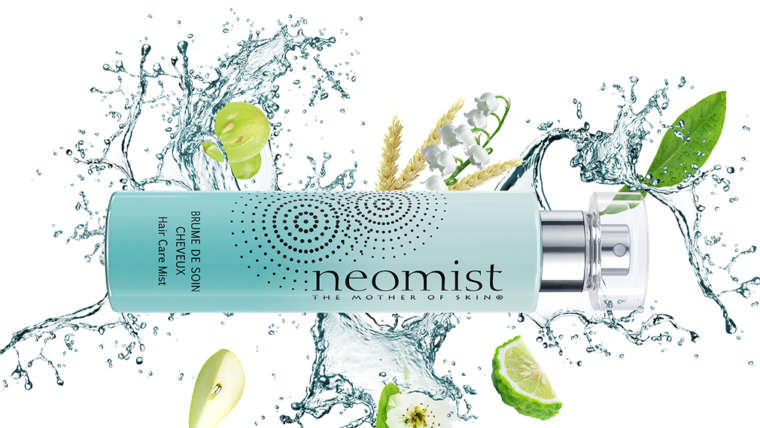Flacon de la brume cheveux Neomist dans un splash d'eau décorée de citrons verts et de feuilles
